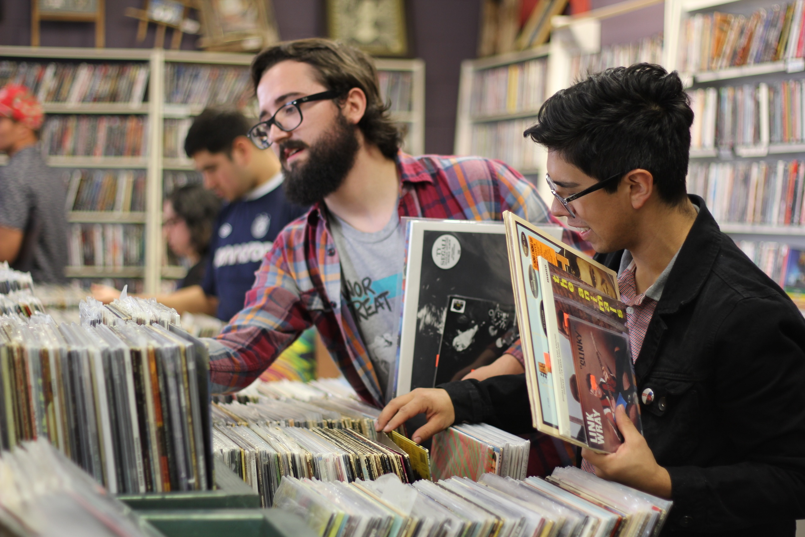 Mason Shirley (left) and Joshua DeLeon browse through the records at Disc Go Round on Record Store Day.