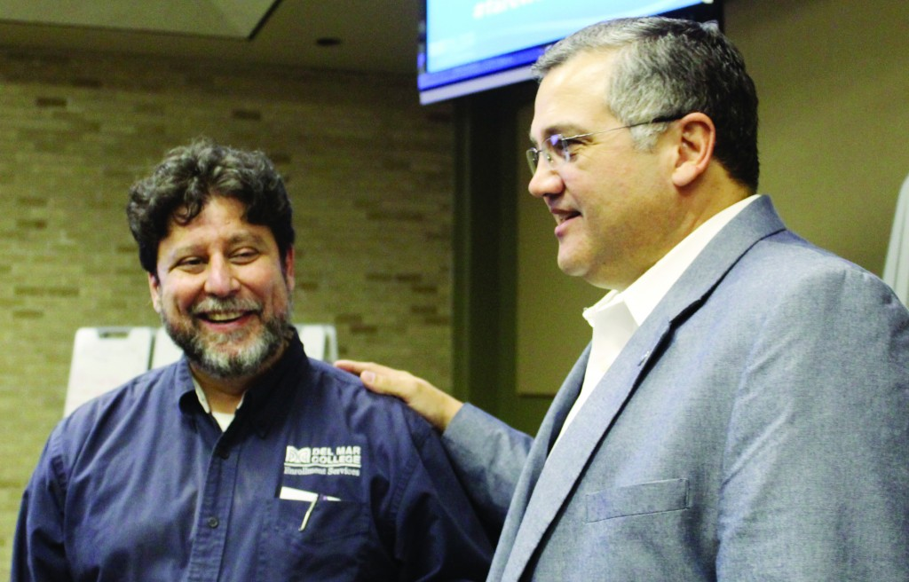 Provost Fernando Figueroa (left) and DMC President Mark Escamilla chat at the farewell event.
