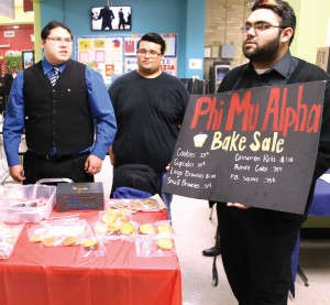 Phi Mu Alpha members conduct a bake sale to raise money during the Spring Break Bash on March 11 in the Harvin Center on East Campus. The event also featured live music and other entertainment.