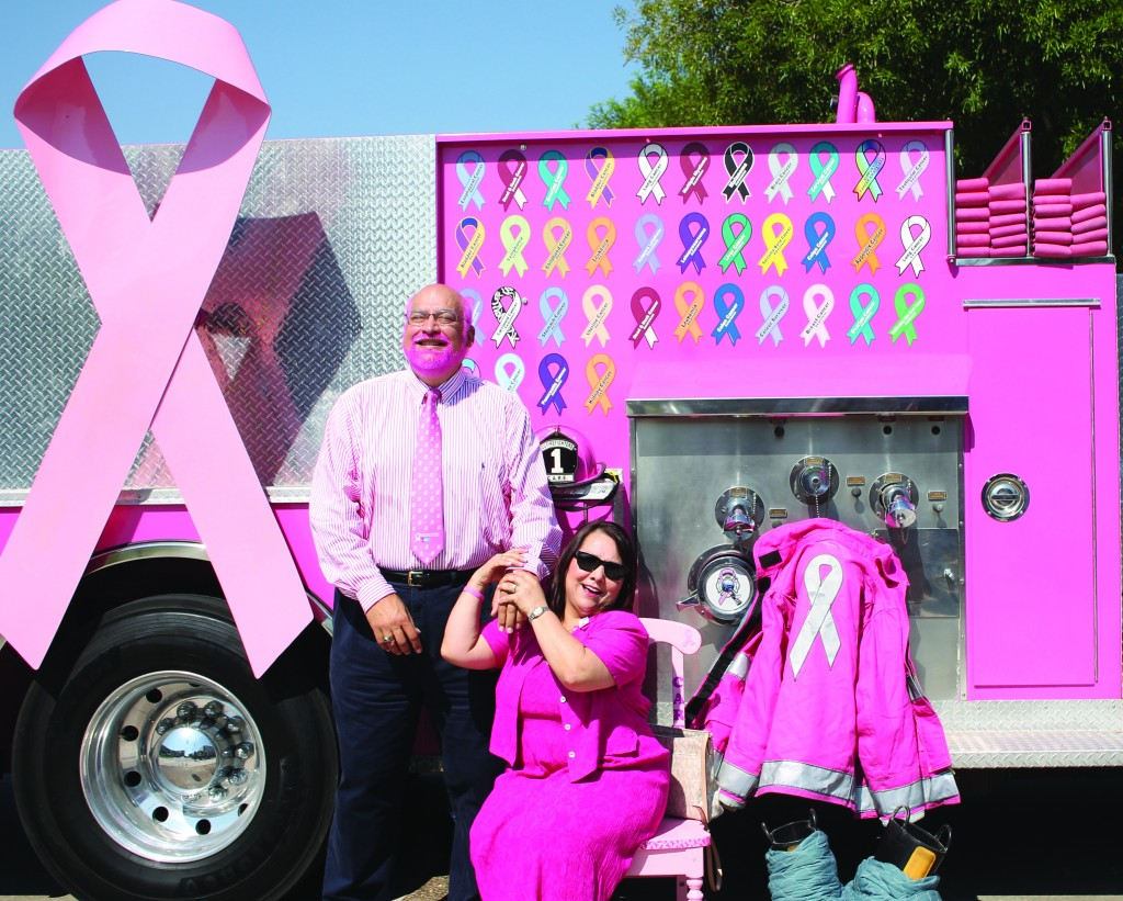 David A Abarca, Associate Professor of Computer Science, poses with Mary Lou Cruz. Mary Lou Cruz is a four year cancer survivor who was nominated to represent the Coastal Bend for the American Cancer Society. Cruz then nominated Abarca to be an ambassador for the Real Men Wear Pink campaign.