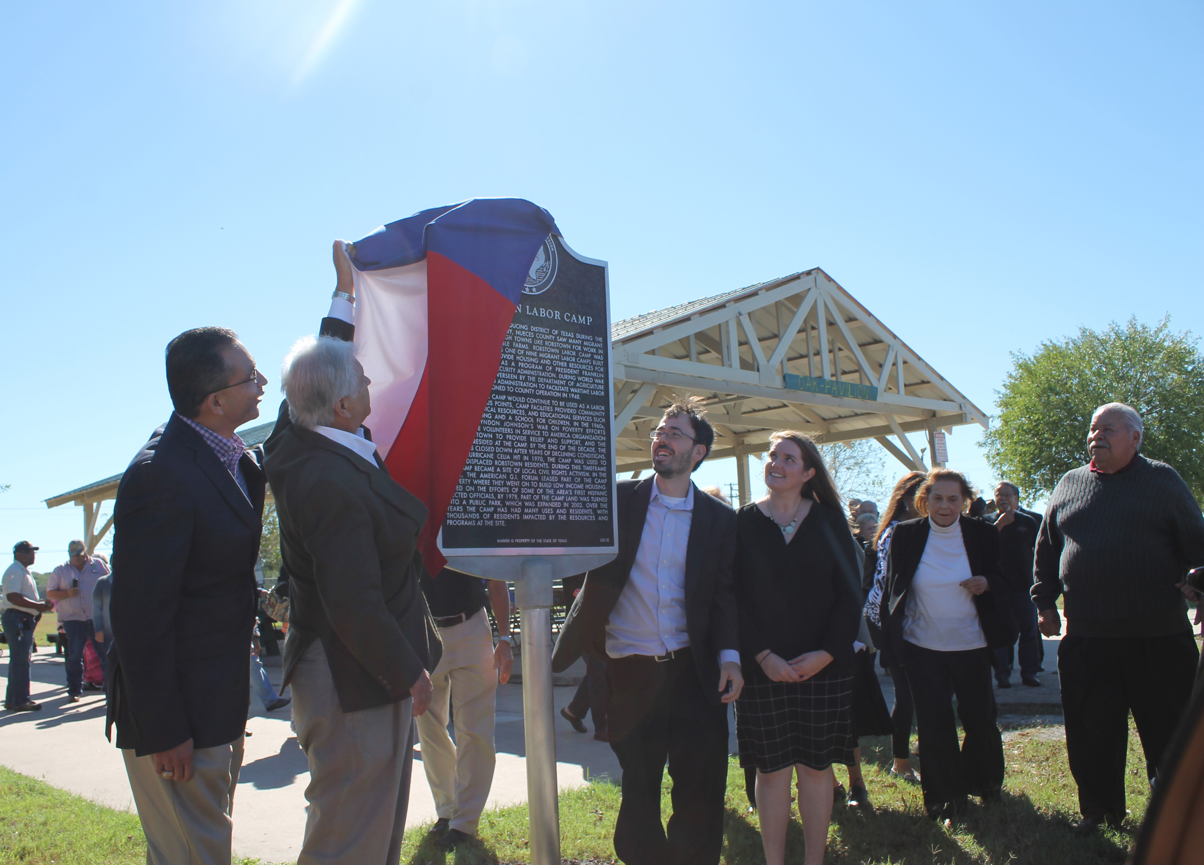 Left to right: State Representative Abel Herrero, Commissioner Oscar Ortiz, Mark Robbins and Christine Robbins unveiling the historical landmark.