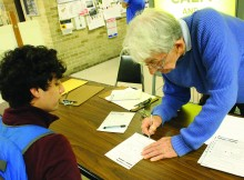 Colin Sykes helps DMC student, Matthew Martinez, register to vote in the Harvin Center