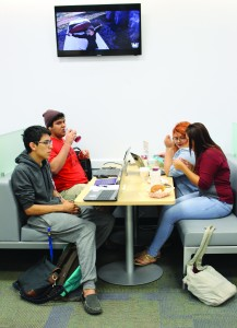 Students relax in the new sleeker booths in the Harvin Center while they break in between classes.