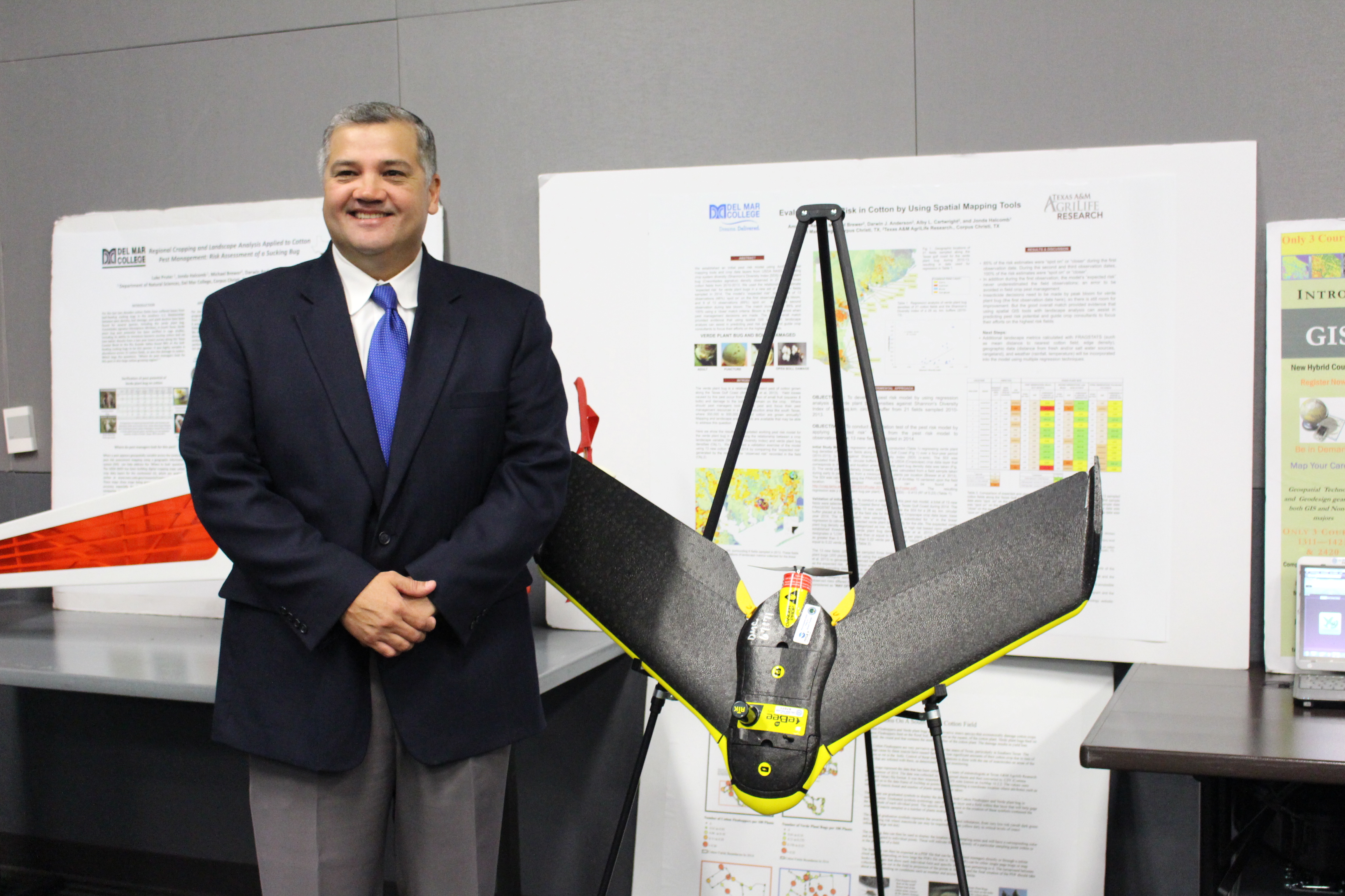 President Mark Escamilla stands next to Del Mar's GIS drone at the event.