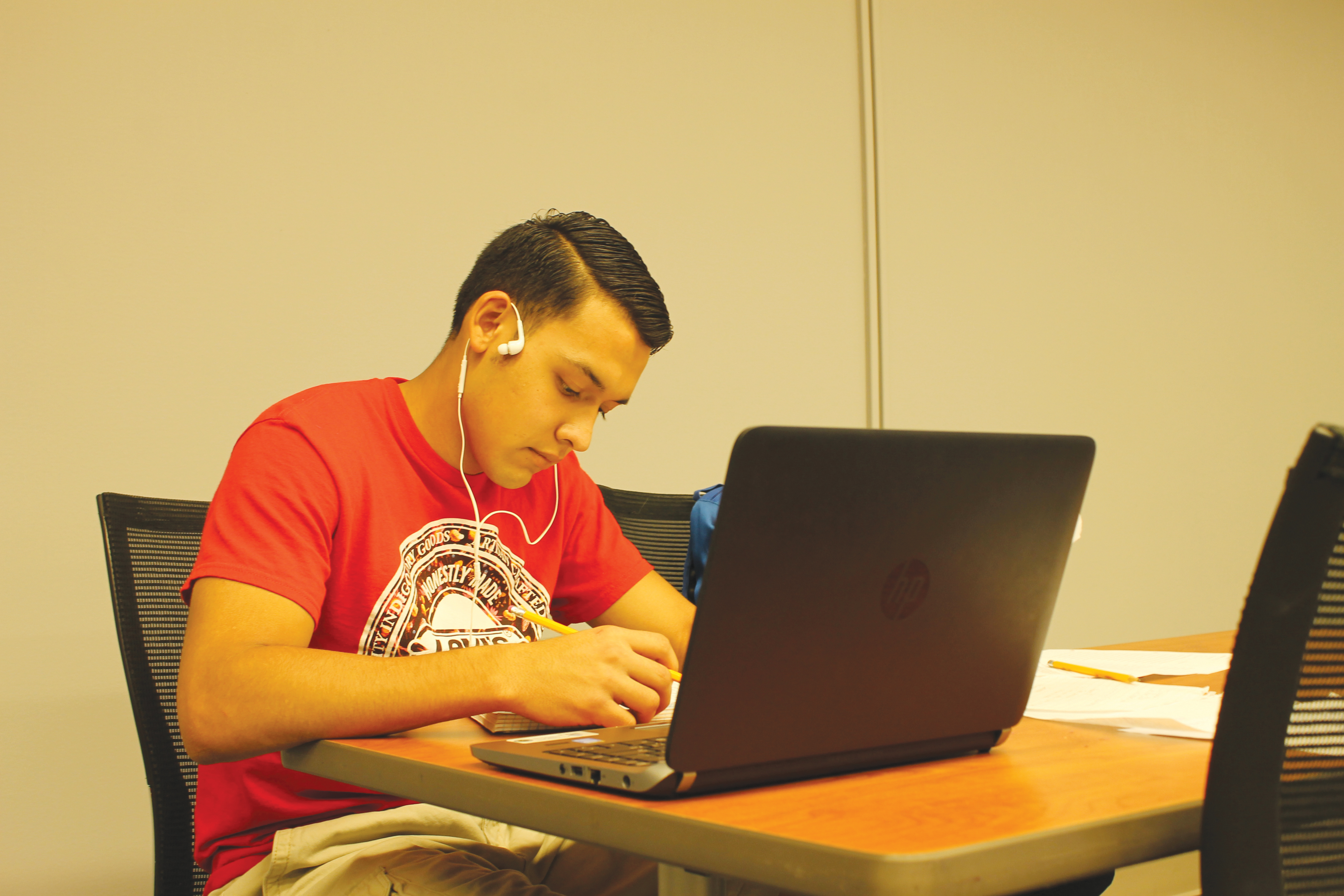 Jay Cantu brainstorms his next essay for his English class while taking advantage of the peace and quiet in the SWC.