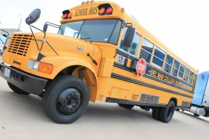 A school bus sits patiently as it waits to be used for safety training.