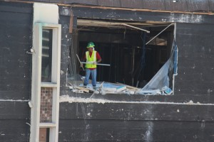 A worker continues to gut the second floor of the English Building on Monday.