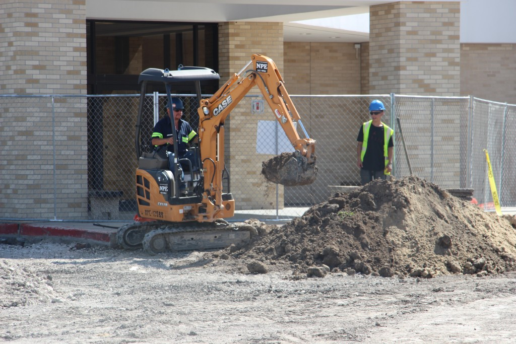 Crews remove the last of the Harvin Center parking lot on Monday.