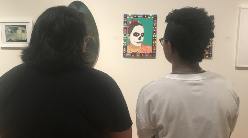 Students Sierra Quintana(right) and Natalie Gomez(left) admire the work of local artists.