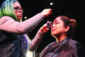 Denise Garza demonstrates her application techniques for students.