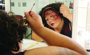 Serrina Hernandez waits for Denise Garza to critique her zombie look. Hernandez only had one hour to create her look.