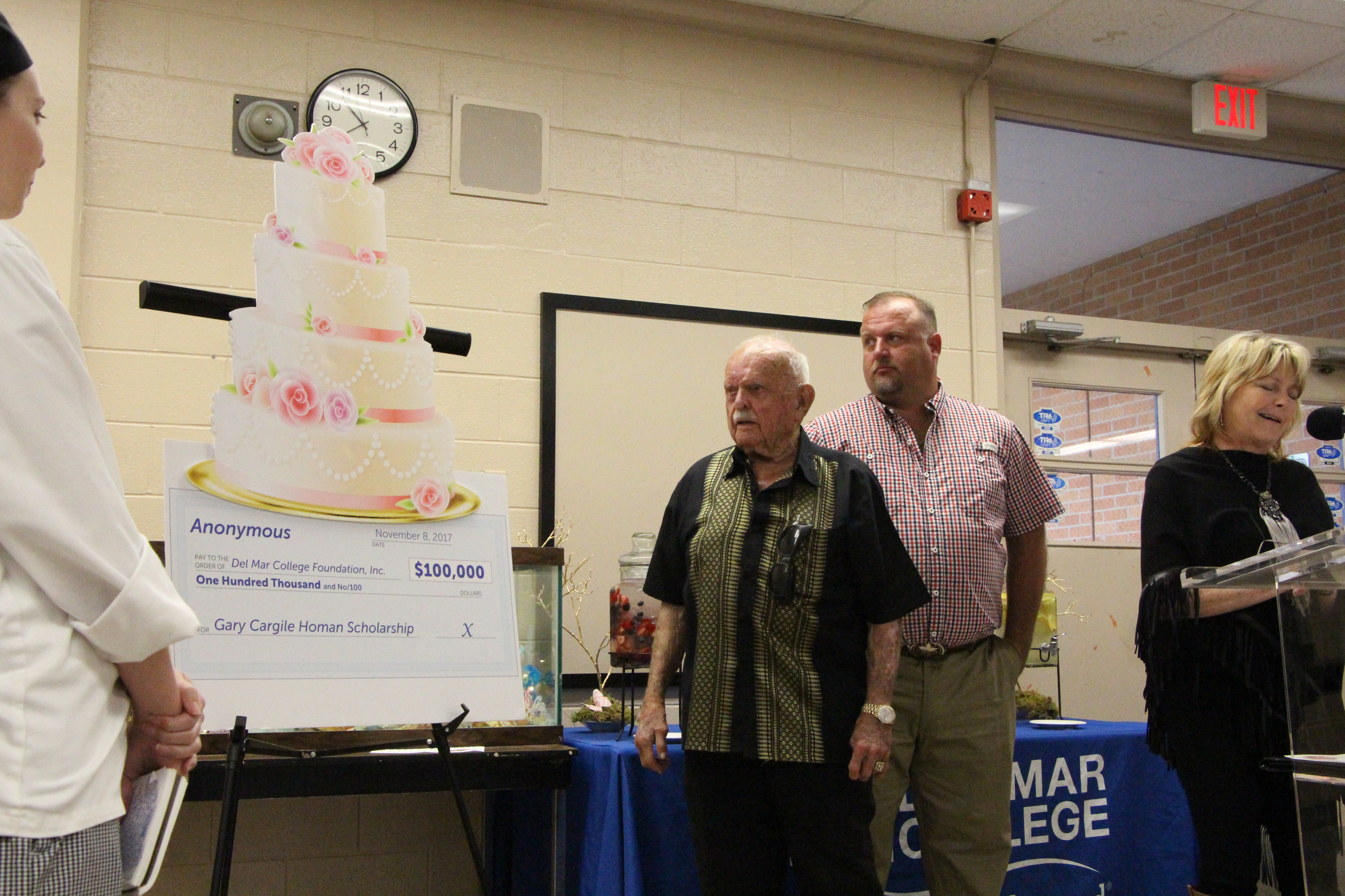 Gus Cargile (from left) and his grandson, Mike Homan, look on as Mary McQueen, with the DMC Foundation, announces a $100,000 donation made in honor of Gus' daughter and Mike's Mom, Gary Homan, on Nov. 15 at West Campus.