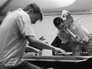 Trevin Roming (left) of The Dirty River Dixie Band goes all out on the piano with Kris Vargas on the trumpet.
