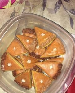 Teeny pumpkin pie slice sugar cookies.