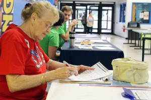 Sandra Heatherley fills out forms at the voting registration table inside the Harvin Center on East Campus Sept. 27.