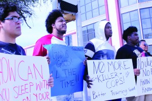 Left to Right Del Mar Students Francisco Aboytes (dental major) Joseph Segovia (nursing major) Charles Gaines (Kine Major) Detrey Cavaness (education major) stand together in peaceful gathering Sunday Oct 22nd